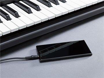 Connecter votre lecteur de musique portable au PSR